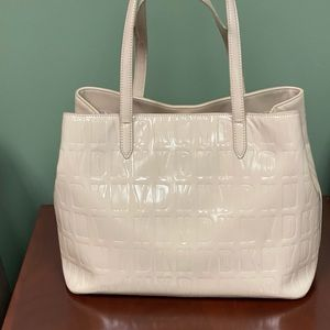 Blush color patent leather DKNY bag
